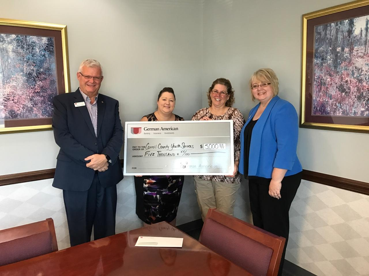 Tracey Reynolds (center-right) accepts a $5,000 donation from German American Bank on behalf of the Carroll County School District's Youth Services Center program.
