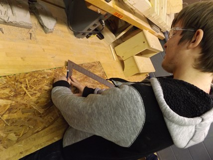 Student working in the carpentry workshop