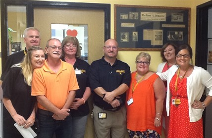CCHS Staff dressed in orange