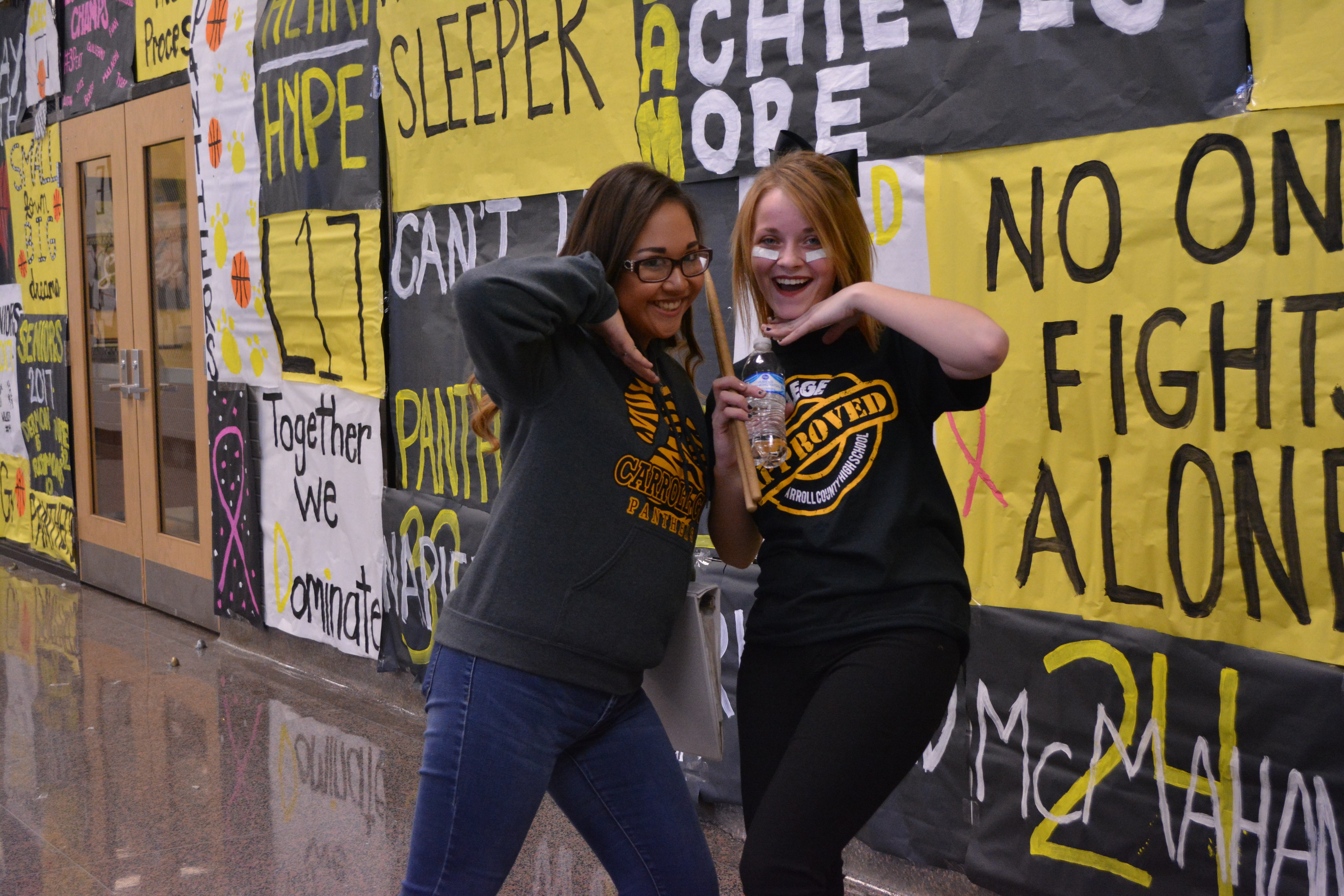 Two students dressed in black and gold