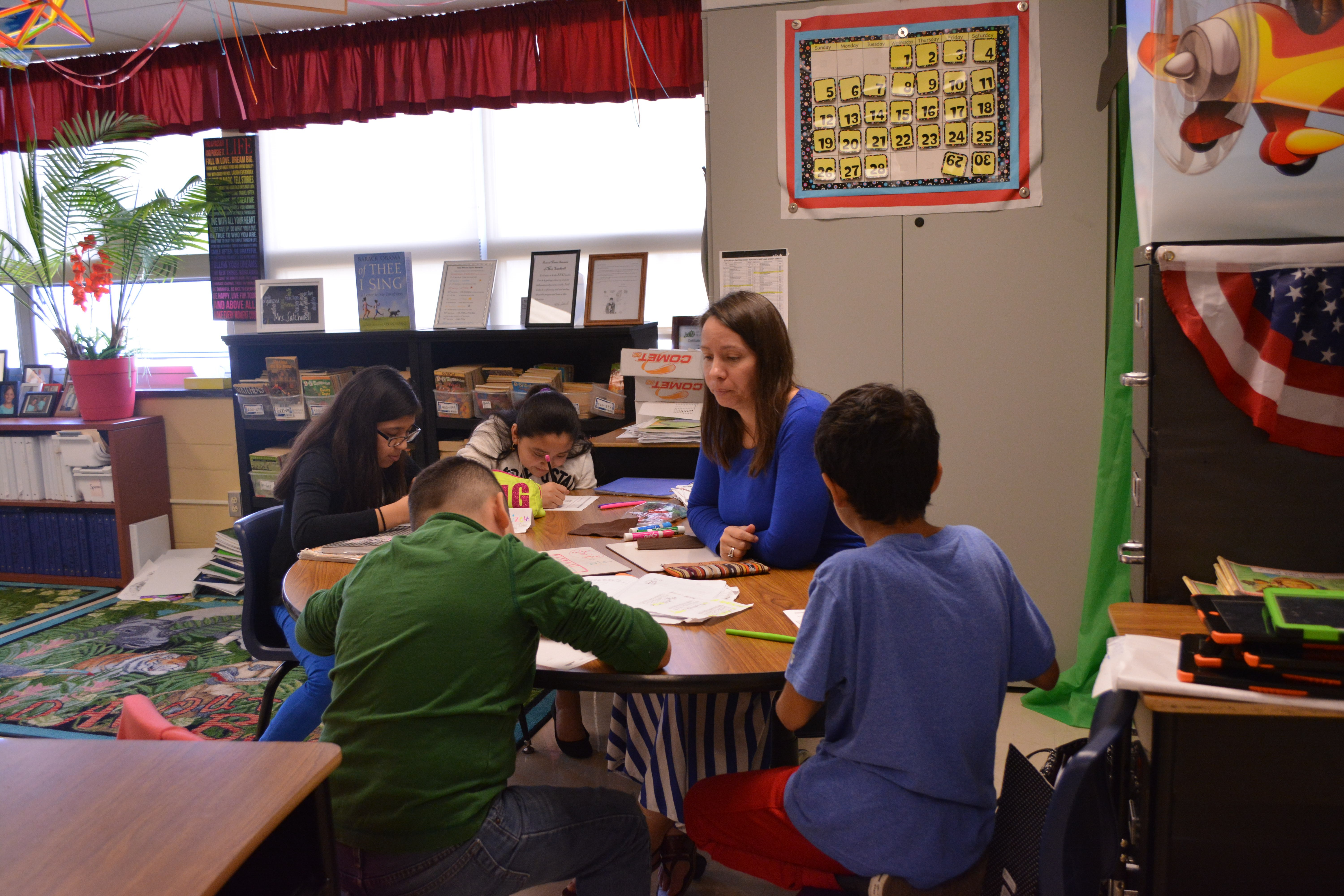 Teacher working with a group of students