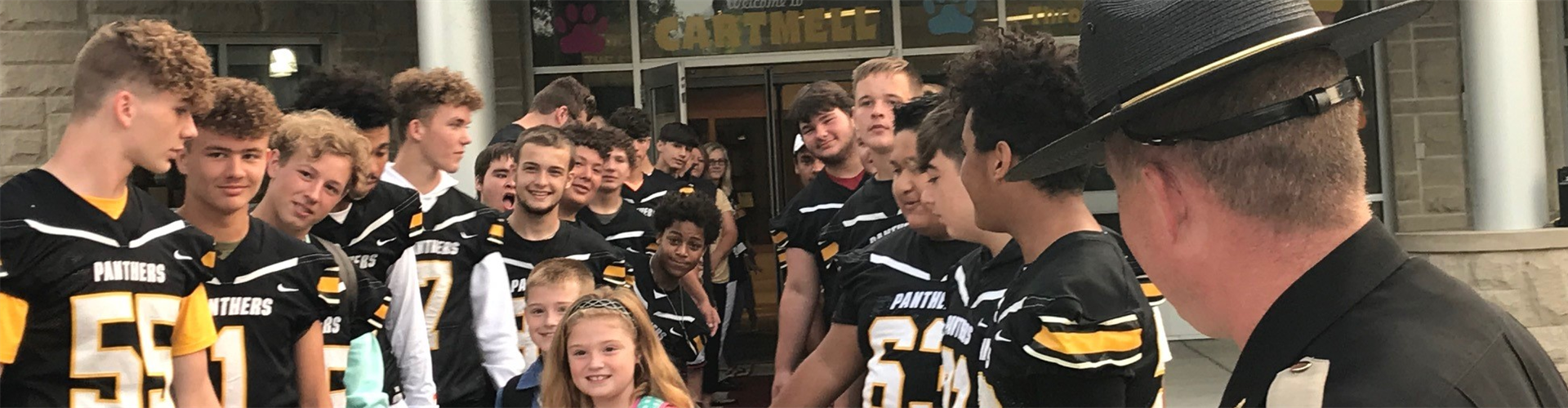 Cartmell students being greeted by the CCHS football team.