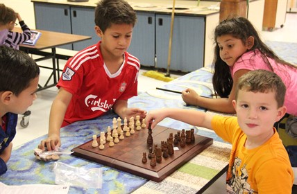 Winn students play chess.