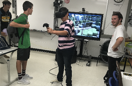 Students using the VR equipment