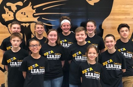 Eleven students wearing BETA Leader shirts